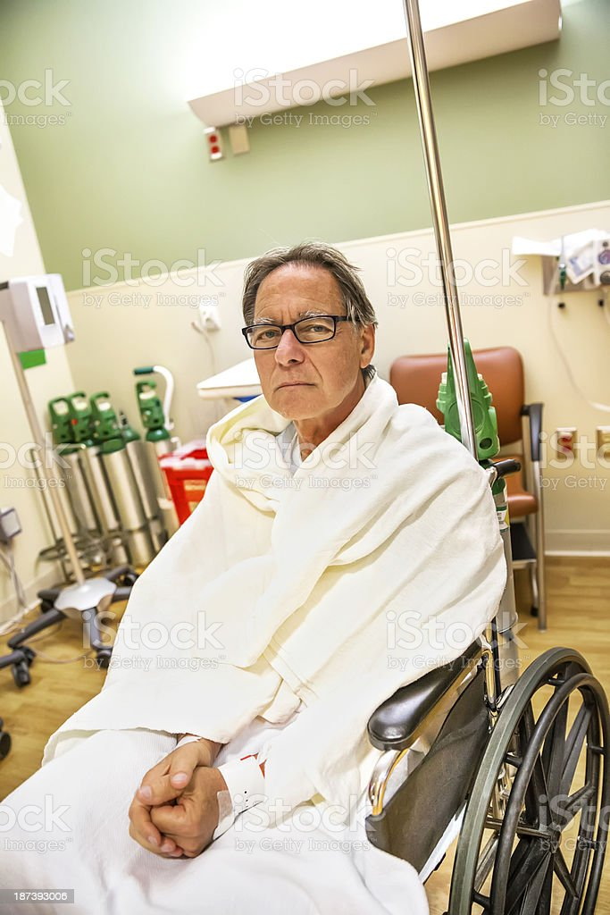 Hospitalized  Senior man sits in a wheel chair royalty-free stock photo