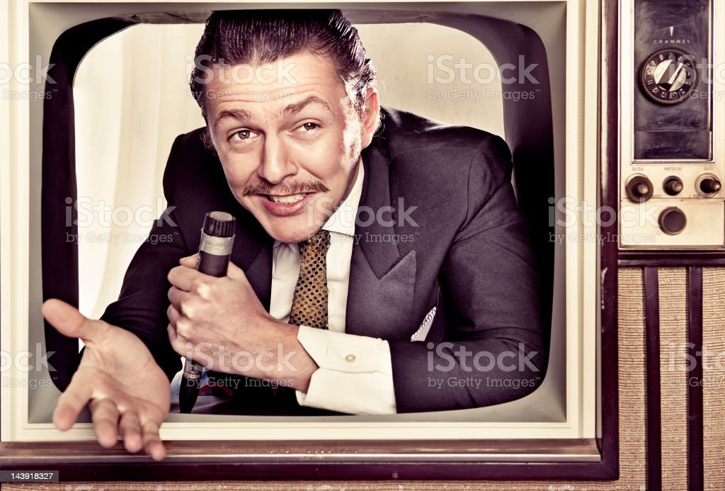 Host coming out of TV stock photo