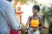 Host welcome woman at hotel / house rental / bed and breakfast accommodation