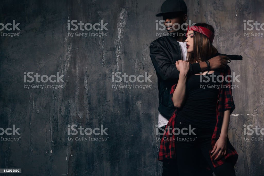 Hostage inlove in gangster with gun stock photo