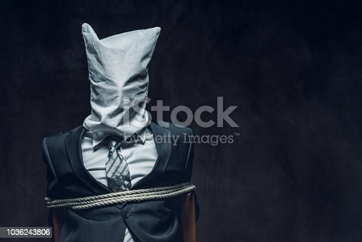 Portrait of kidnapped businessman. Hostage, slavery concept.