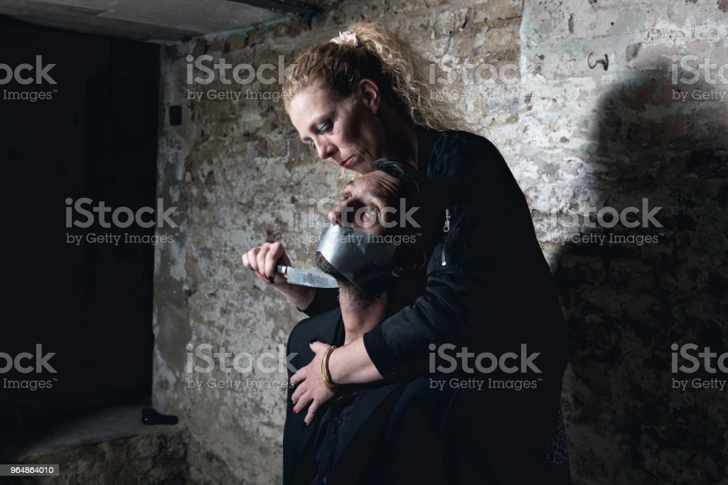 hostage threatened with knife royalty-free stock photo