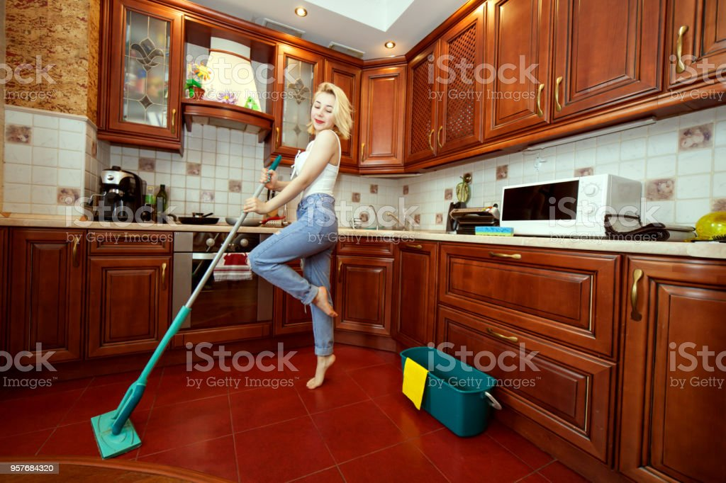Hostess dances during the cleaning. stock photo