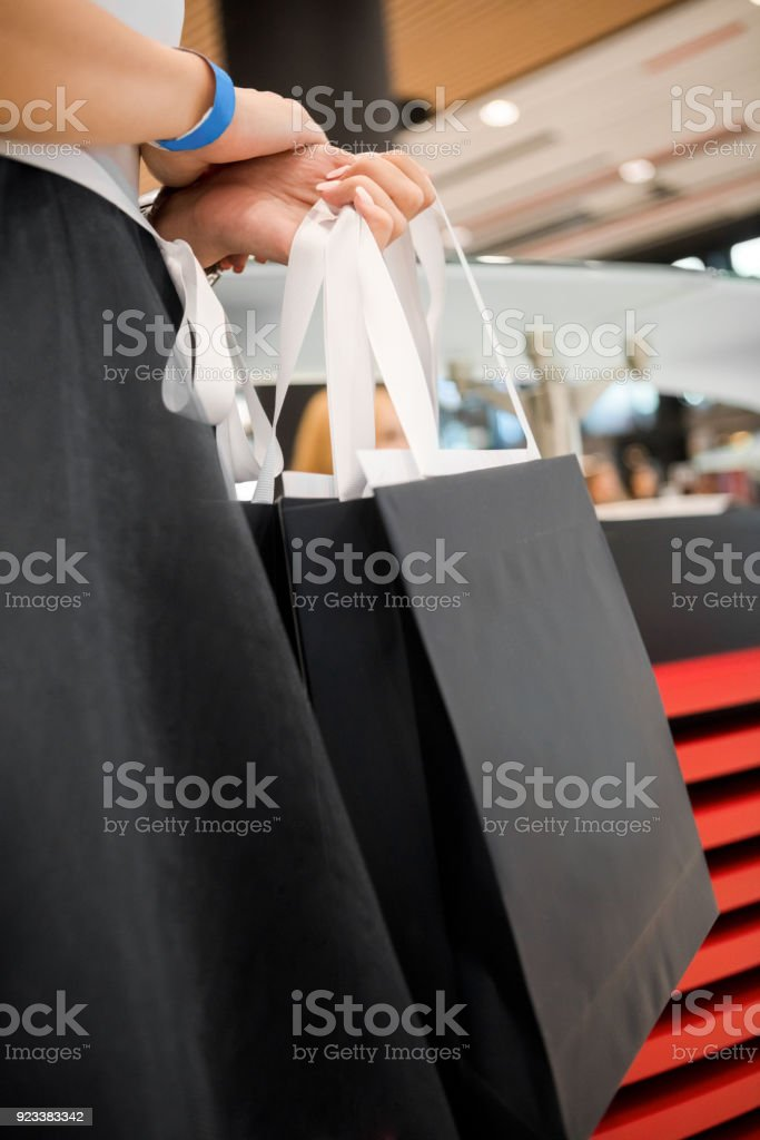 Hostess holding goodie bags stock photo