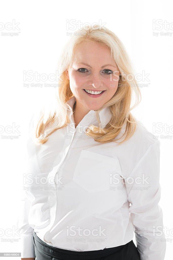 Hostess Standing Against White Background photo libre de droits