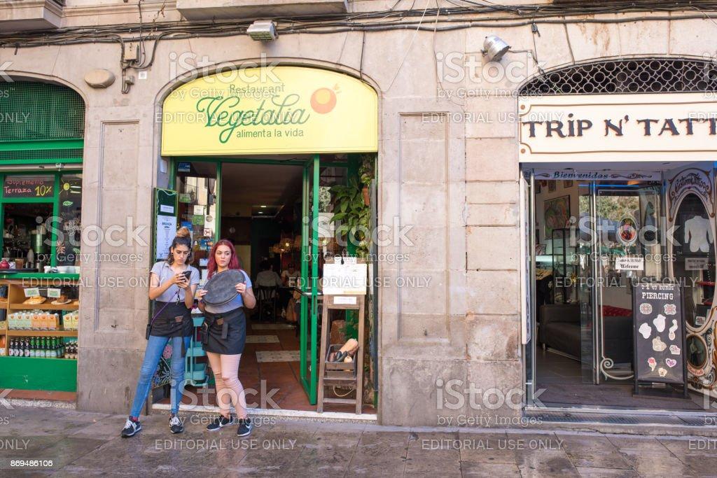 Hostesses outside a restaurant in Barcelona stock photo