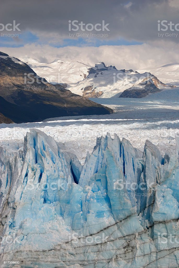 Hostile glacier Perito Moreno with mountain background stock photo