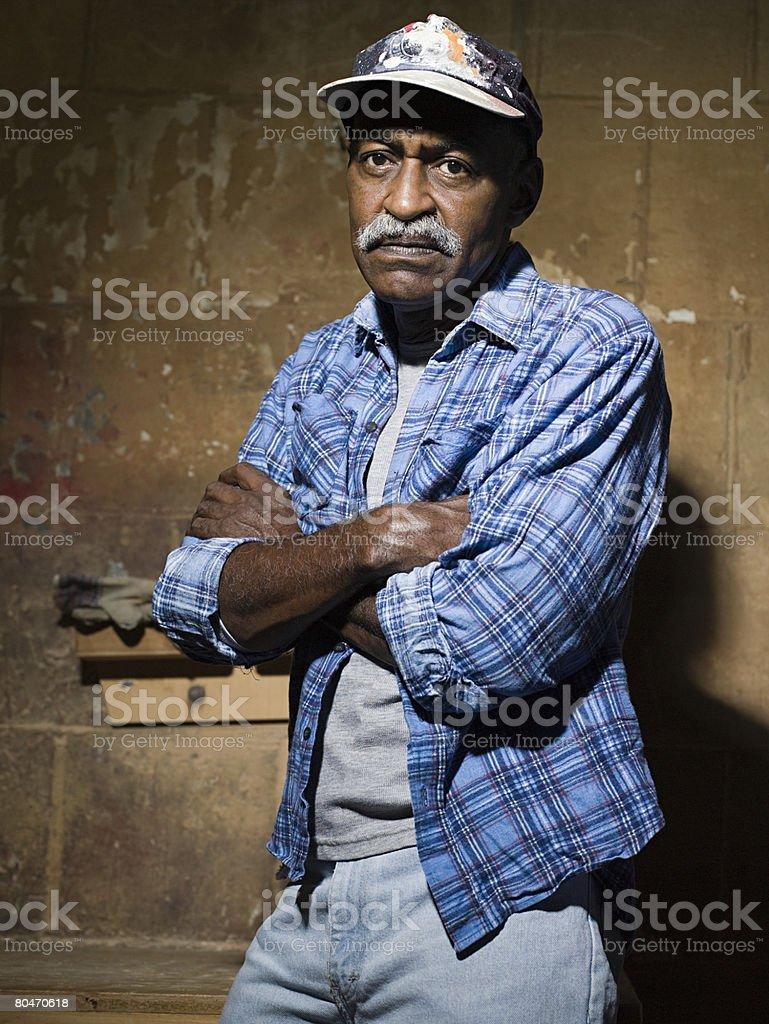 Hostile looking senior man stock photo