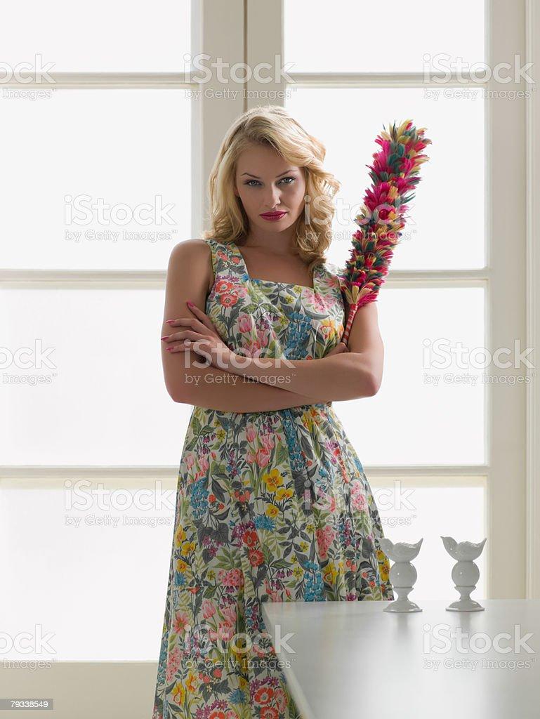 Hostile woman holding a duster 免版稅 stock photo