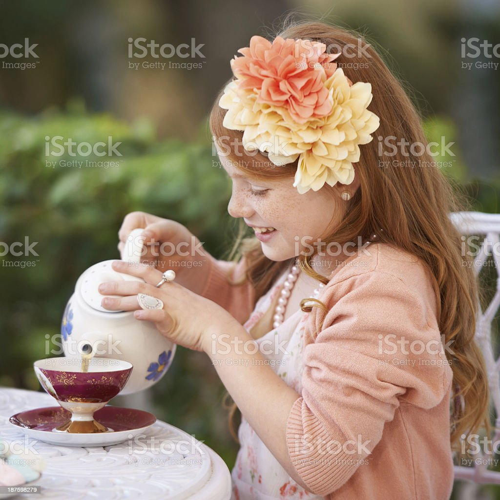 Hosting her tea party royalty-free stock photo
