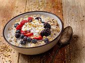 istock Hot 7 Grain Breakfast Cereal With Yogurt and Fresh Fruit 613121170