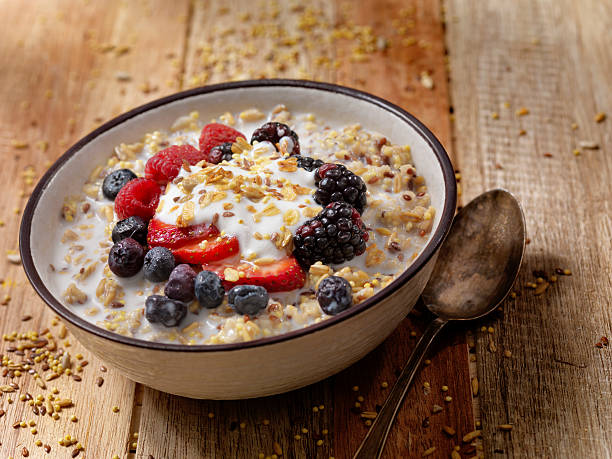 Hot 7 Grain Breakfast Cereal With Yogurt and Fresh Fruit Granola With Fresh Fruit-Photographed on Hasselblad H1-22mb Camera oatmeal stock pictures, royalty-free photos & images
