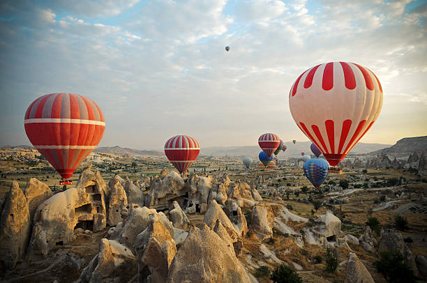 Hot Air Ballons of Cappadocia Hot Air Ballons flying on the sky of mysterious Cappadocia tuff stock pictures, royalty-free photos & images