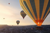 """Cappadocia, a semi-arid region in central Turkey, is known for its distinctive """"fairy chimneys,"""" tall, cone-shaped rock formations clustered in Monks Valley, Göreme and elsewhere."""