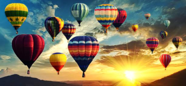 hot air balloon above high mountain at sunset - hot air balloon стоковые фото и изображения