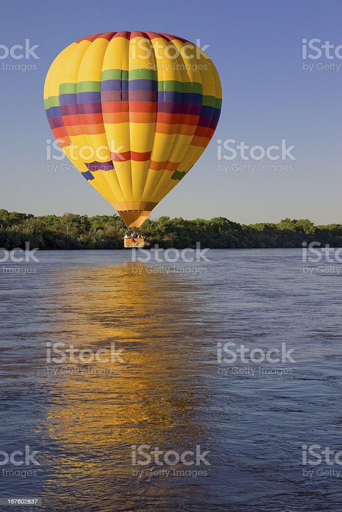 Hot Air Balloon Above Rio Grande River, Sunrise, Albuquerque, Reflection stock photo