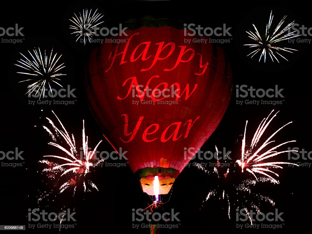Hot air balloon and firework in the New Year's eve foto royalty-free