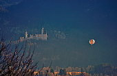Hopfen, Bavaria -Germany  January  2002: Hot Air Balloon at sunset with King Ludwig Neuschwanstein Castle in the background .