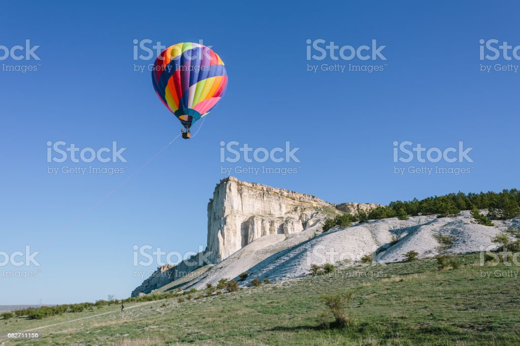 Hot Air Balloon Floating near White Rock stock photo