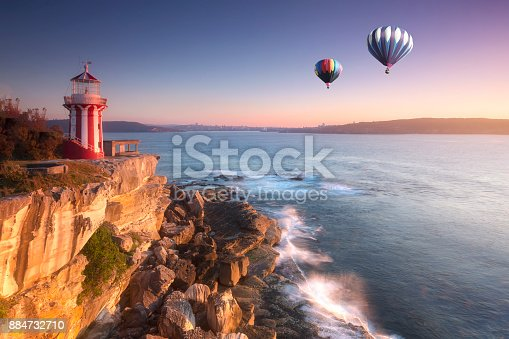 istock Hot air balloon fly over hornby lighthouse at watsons bay, Sydney, Australia 884732710