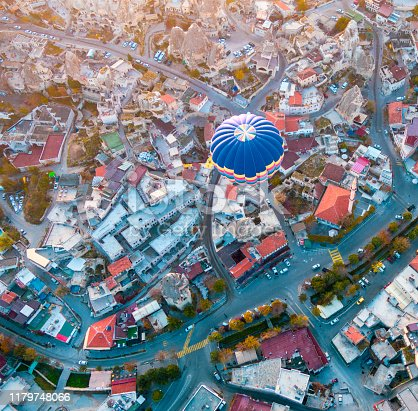 515376634 istock photo Hot air balloon flying at dawn over the city of Cappadocia in Turkey. View from above. 1179748066