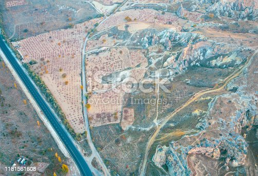 515376634 istock photo Hot air balloon flying at dawn over the city of Cappadocia in Turkey. View from above. 1181561608