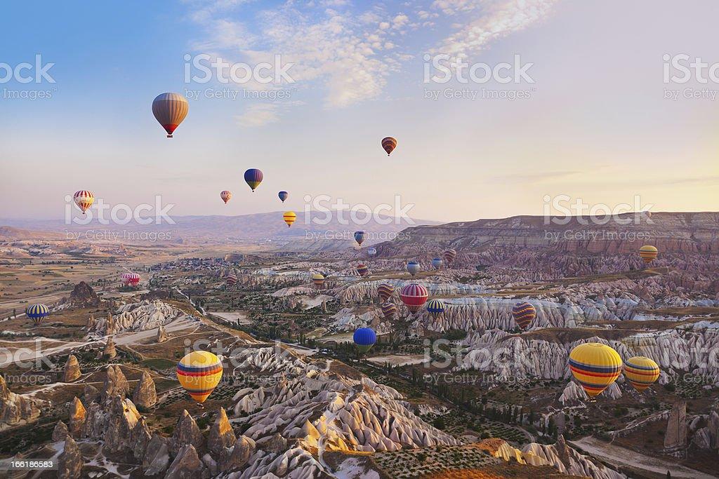 Hot air balloon flying over Cappadocia Turkey stock photo