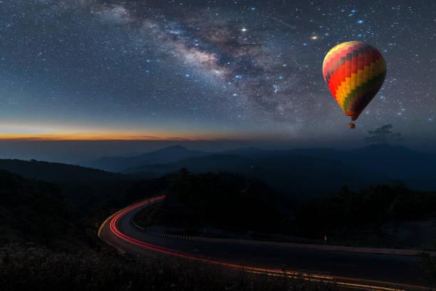 hot air balloon flying over chiang mai viewpoint - hot air balloon стоковые фото и изображения