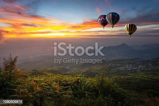 Hot air balloon flying over Phu Tab Berk hill in morning