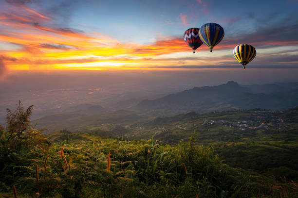 Hot air balloon flying over Phu Tab Berk hill in morning stock photo