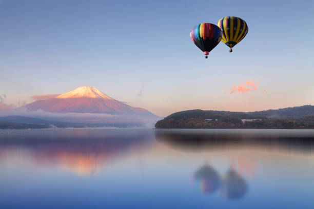Hot air balloon flying  over the lake with Mount Fuji in background Hot air balloon flying  over the lake with Mount Fuji in background lake kawaguchi stock pictures, royalty-free photos & images