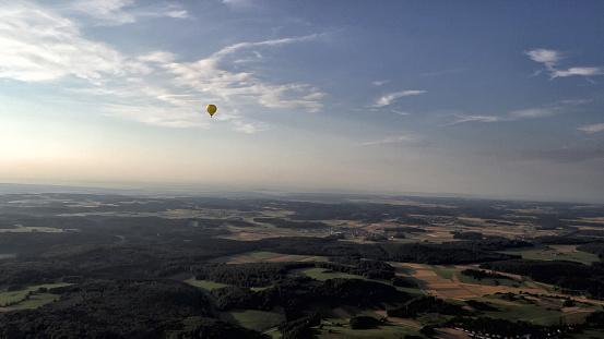 hot air balloon high above the ground