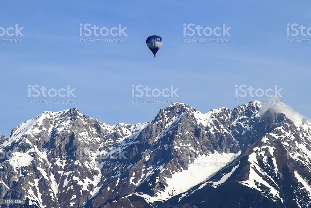 Hot air balloon high in the mountains. royalty-free stock photo