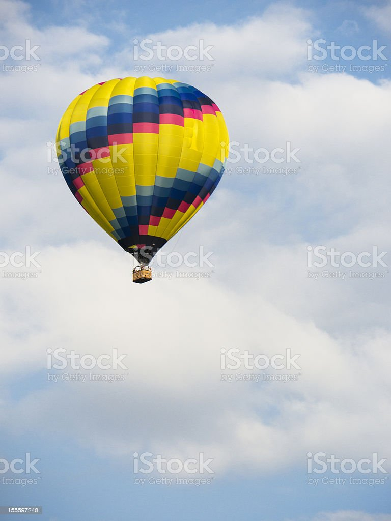 Hot air balloon in a blue sky royalty-free stock photo