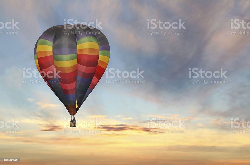 hot air balloon in colorful sunrise sky royalty-free stock photo