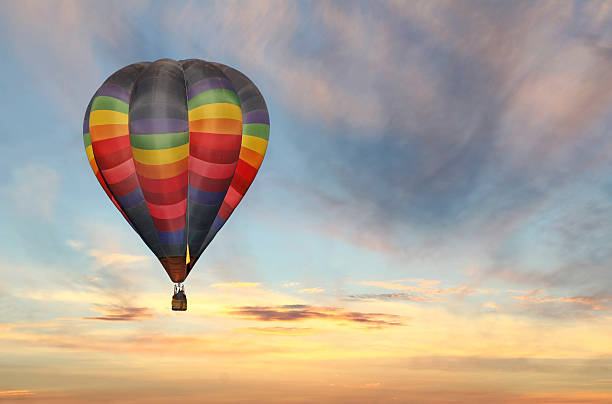 hot air balloon in colorful sunrise sky stock photo