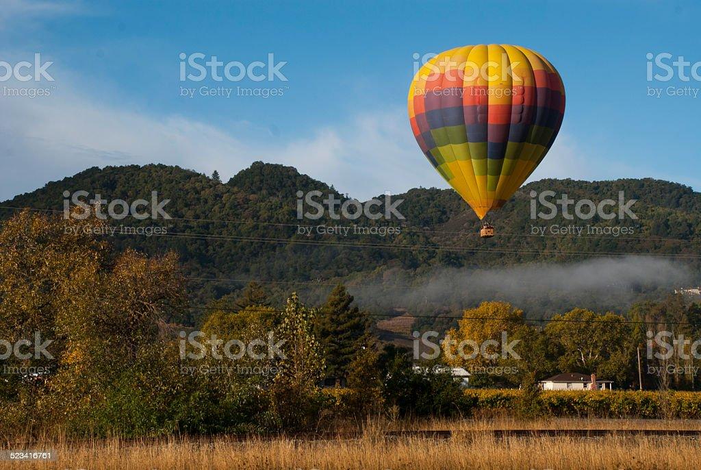 Hot air Balloon Napa Valley early morning fog Yountville California stock photo
