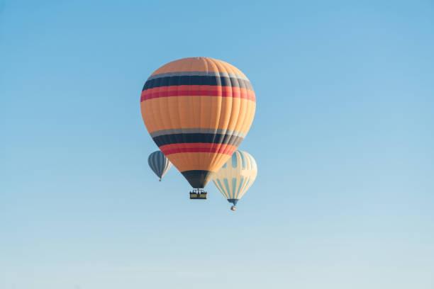 hot air balloon on a blue background - hot air balloon стоковые фото и изображения