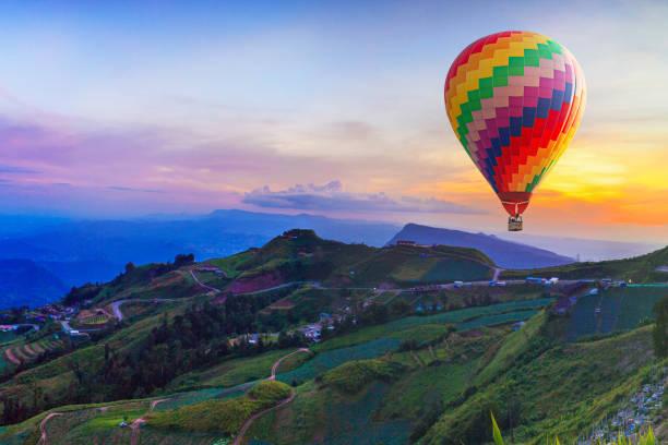 hot air balloon on beautiful mountain - hot air balloon стоковые фото и изображения