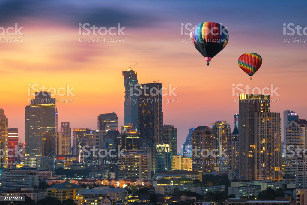 Hot air balloon over Bangkok business district at dusk, Thailand stock photo