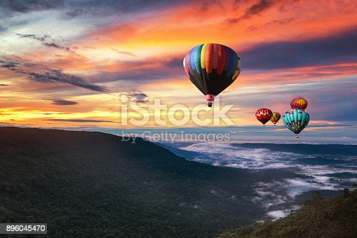 844061492 istock photo Hot air balloon over Khao yai national park in morning with beautiful sky, Thailand 896045470