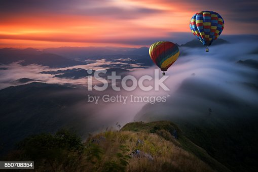 istock Hot air balloon over Pha Tang hill with beautiful mountain view and fog in morning, Chiang rai, Thailand 850708354