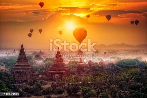 Hot air balloon over plain of Bagan in misty morning, mandalay Myanmar