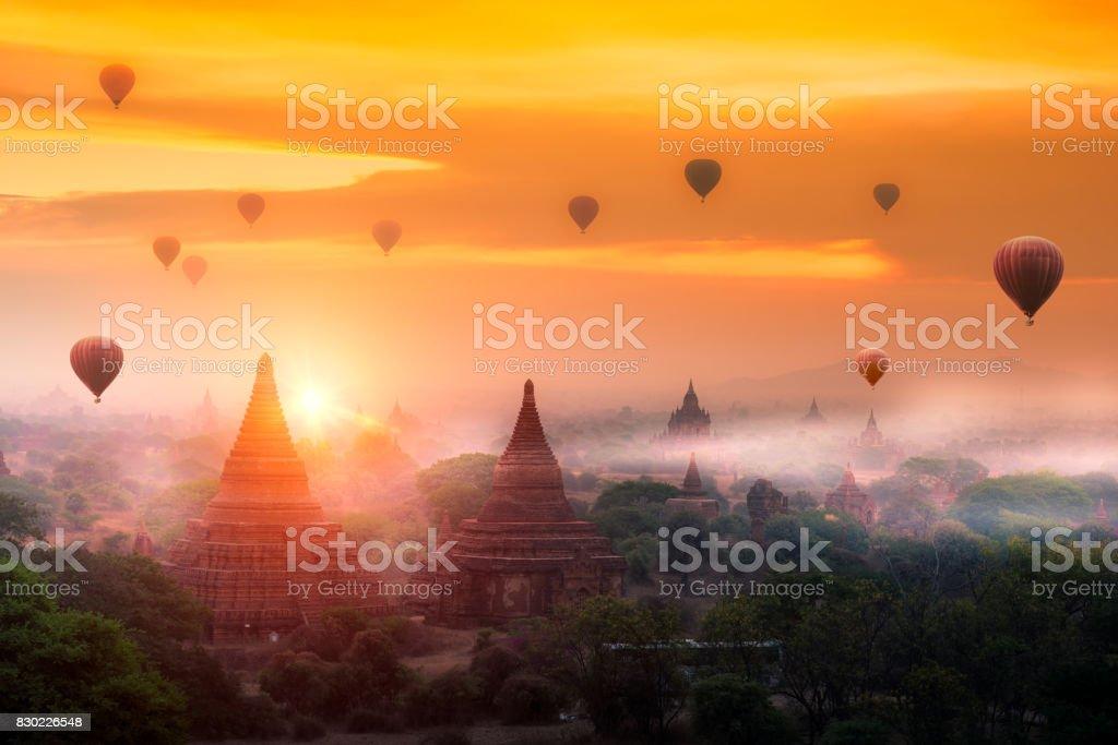 Hot air balloon over plain of Bagan in misty morning, Mandalay, Myanmar stock photo
