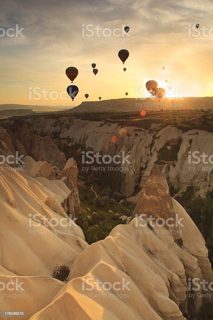 Hot air balloon over rock formations in Cappadocia stock photo