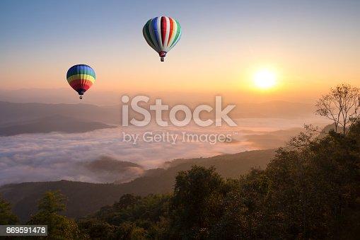 844061492 istock photo Hot air balloon over  sea of cloud at Doi Samer dao hill in morning, Nan province, Thailand 869591478
