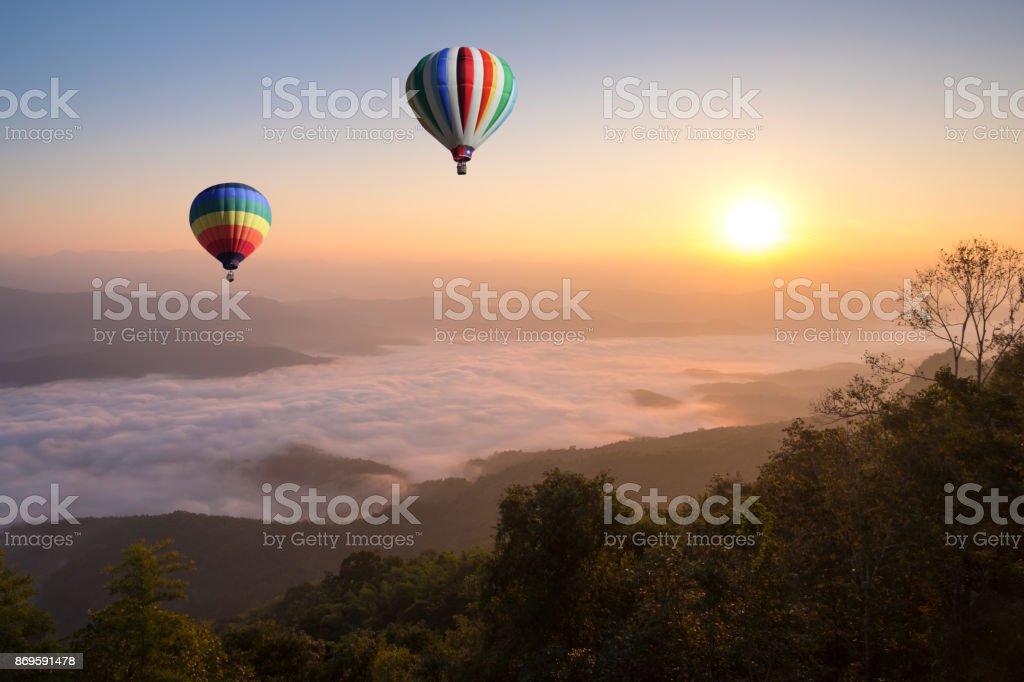 Hot air balloon over  sea of cloud at Doi Samer dao hill in morning, Nan province, Thailand stock photo