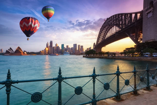 Hot air balloon over Sydney bay in evening, Sydney, Australia stock photo