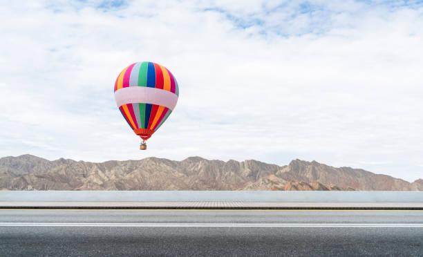 hot air balloon over the danxia landform stock photo