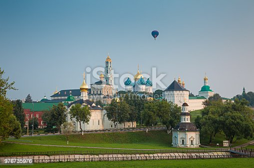Hot air balloon flying over the Trinity St. Sergy Monastery in dawn. Sergiev Posad, Russia